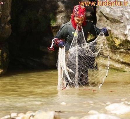 عکس جالب الناز شاکردوست در حال ماهیگیری با تور